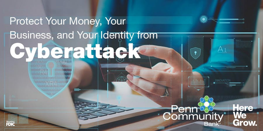 protect your money and bank account from cyber attacked with penn community bank, image of hands looking at a debit card at a laptop