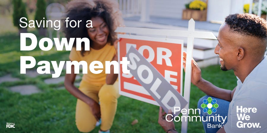 saving for a down payment image, two new homeowners crouching in front of a sold house and smiling at each other